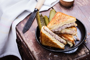 Homemade tuna melt sandwich served warm with pickles