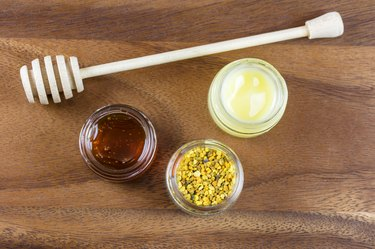 Raw organic bee pollen, royal jelly and honey in jar. Bee pollen granules. Apitherapy.