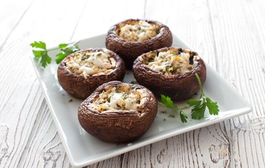 Mushrooms stuffed with cheese and greens