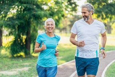 Senior couple power walking on a track