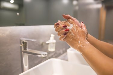 Business woman hand washing with soap to prevent Coronavirus
