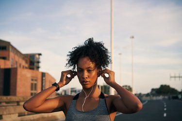 Woman about to go for a run with music on a running streak