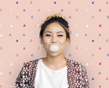 Young Girl Chewing Bubble Gum Concept