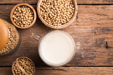 Glass with Soy Milk and Seeds on background