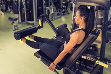 Woman Doing Leg Extensions