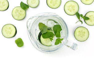 Cucumber and mint lemonade in a jar on a white background with place for text