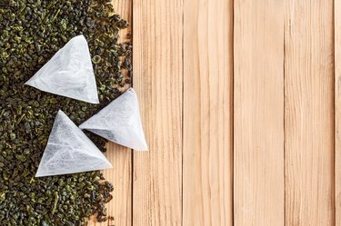 Tea in bags on the dried leaves of tea