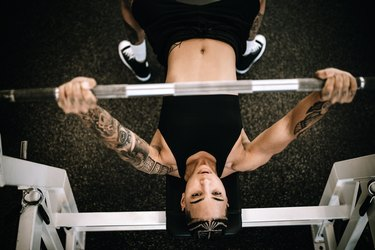 Strong and Fit Woman Working Out in Gym