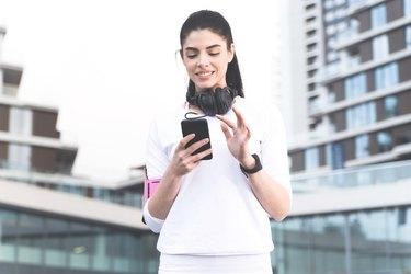 Woman using walking app to track walking workout