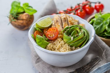 Fresh healthy salad in bowl and ingredients