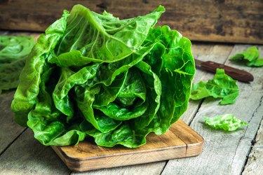 green butter lettuce head on wood