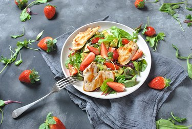 Plate of salad with chicken, strawberries and avocado
