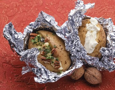 Baked potato with sea salt and walnuts and sour cream.