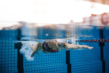 Female swimmer training in the swimming pool