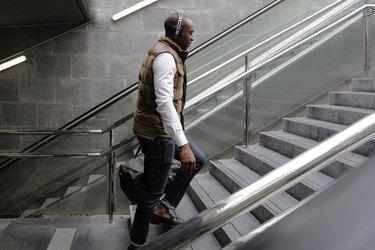 Side view of man climbing steps at subway station