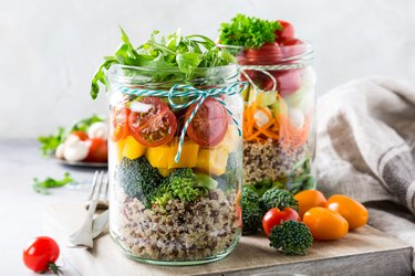 Salad in glass jar with quinoa for healthy lunch recipes