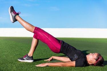 woman doing single-leg bridge exercise to fix a muscle imbalance