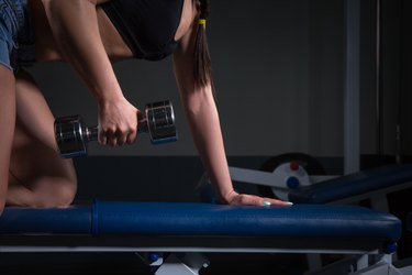 woman exercising dumbbell row at the gym. fitness. halthy concept
