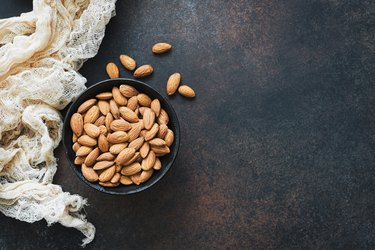 Raw almonds in bowl