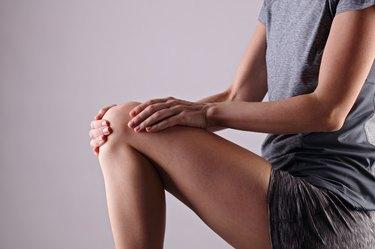 Women with knee pain. Sport exercising injury