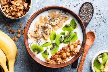 Tropical fruit bowl with granola and yogurt