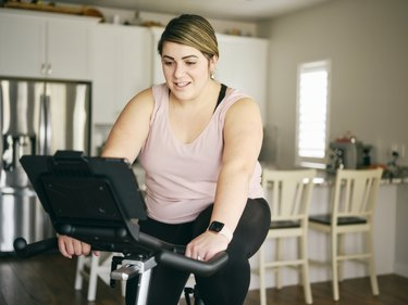 woman doing 20-minute stationary bike workout at home