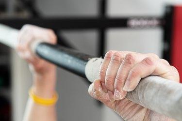 Closeup of hands holding a pull-ups bar