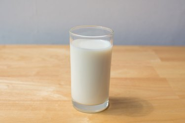 Milk In Glass On Table