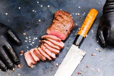 steakhouse food striploin steak beef meat knife
