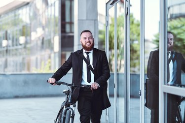 Environmental Conservation Shown By Male Businessman Going To Work By Bicycle