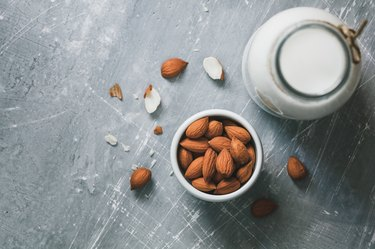 Directly Above Shot Of Almonds By Milk On Table