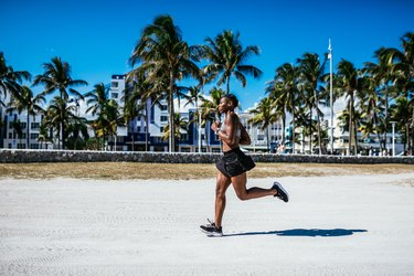 Puertorican woman jogging in the morning near the beach in USA