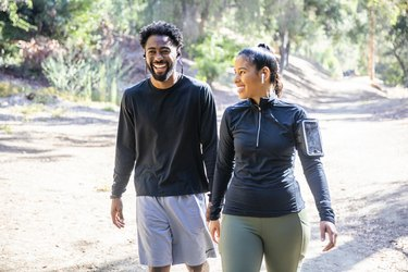 Couple walking outside for exercise and stress relief