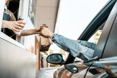 person at a drive-thru getting healthy fast food options