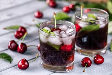 Tart cherry juice on wooden background