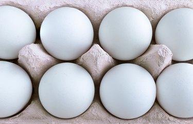 Shot of blue eggs in carton.