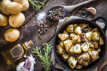 Roasted potatoes on wooden kitchen table