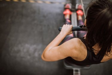 Woman Doing Workout Drill on Rowing Machine