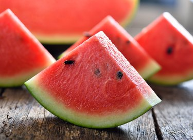 watermelon slices on a wooden background