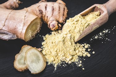 Ground ginger in a wooden scoop