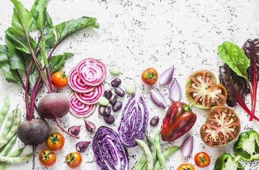 Variety of vegetables a light background. Beets, red cabbage, beans, tomatoes, red onions, peppers food background. Vegetarian food concept