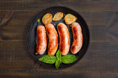 Barbecue sausages in frying pan