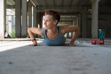 Girl doing push-up exercise outdoor