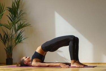 sporty female doing gym exercise