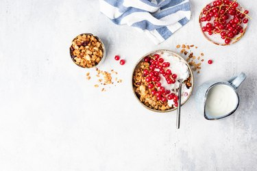 Granola bowl with yogurt and red currant berries