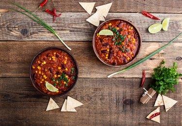 Chili con carne stew served in ceramic bowll
