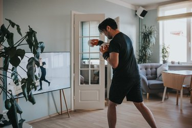 Man doing an online boxing workout in his living room