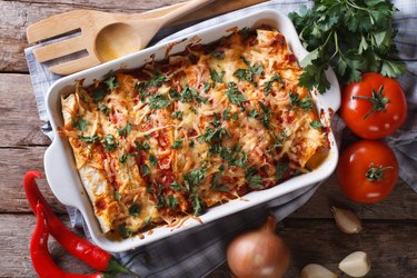 Mexican enchilada in a baking dish horizontal top view close-up