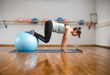 Woman doing ab workout with a fitness ball