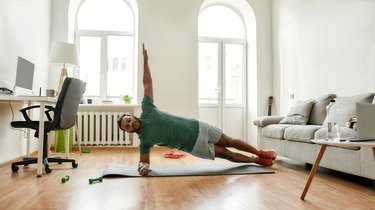 Man performing side plank exercise.